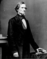 Jefferson Davis: a white man standing in a black suit