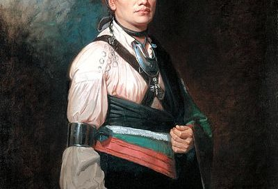 Joseph Brant, standing wearing dramatic European clothing