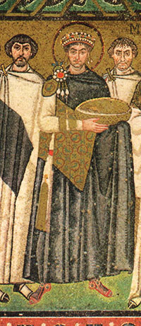 Justinian in a mosaic - a white man with a halo and a crown, in elaborate robes, carrying a gold bowl - Justinian Byzantine