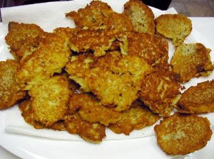 Potato latkes cooked in oil are a traditional Hanukkah food