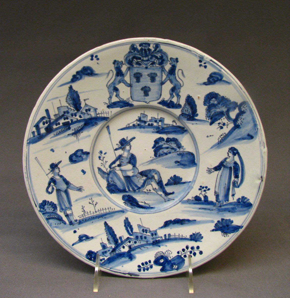 blue and white plate with french scenes
