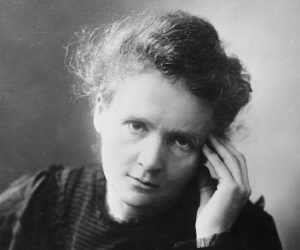 Marie Curie, a white woman with her hair up