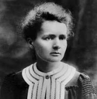 Marie Curie: a white woman with her hair up