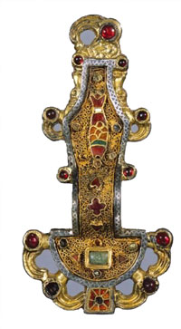 A gold and garnet Merovingian fibula from early France