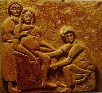 A Roman carving of a midwife at a birth(Isola Della Sacra, Ostia, 1st century AD)