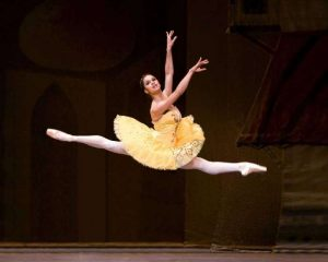 Misty Copeland, a black ballet dancer jumps high