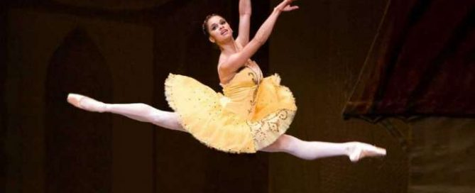Misty Copeland, a black ballet dancer jumps high
