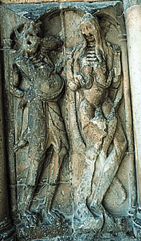 Devils torture the damned in Hell (Abbey of Moissac, about 1050 AD)