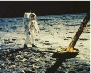 A man in a spacesuit walks on the moon