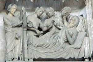 Nicholas hands the purses through the window to the poor girls (Chartres Cathedral)