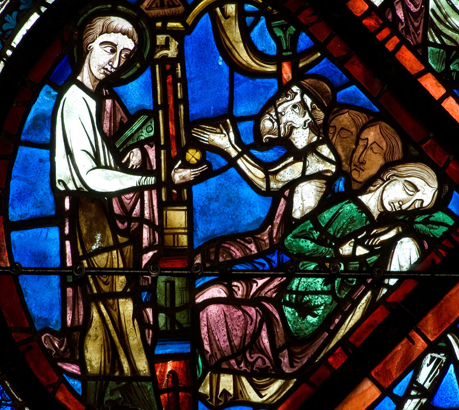 In another version of this story, St. Nicholas gives the dad the money while the daughters sleep (also from Chartres Cathedral, about 1200 AD)