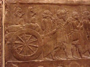 Wheeled wagon carrying prisoners of war(Nineveh, Iraq, 700 BC)