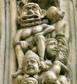 A demon torturing a sinful bishop and a king(Notre Dame Cathedral, Paris, 1200s)
