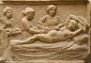 Midwives help a woman deliver the placenta (Roman Ostia)