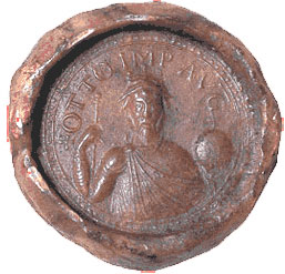 Otto I (on a seal) - Otto the Great. A red blob of wax with the image of a man and some letters stamped on it. The man holds an orb of the world.