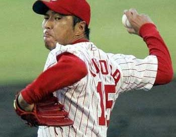 A Latino baseball player throwing a ball