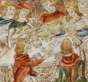 White men sitting at a table playing cards: medieval games