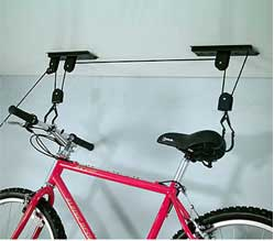 A set of movable pulleys to pull a bike up to the ceiling