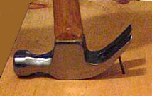 A hammer used as a lever