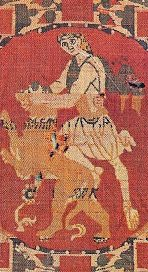 Samson (or David?) wrestles the lion. Silk tapestry, probably from Syria, in the 600s AD