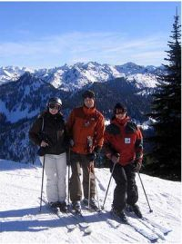Skiers wearing heavy coats on a sunny day