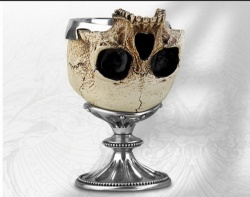 A silver cup made with an upside down human skull
