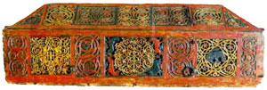 An elaborately decorated wooden coffin brightly painted in red and yellow - Early Slavs
