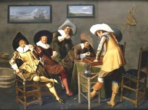 five white men partying with pipes and a backgammon board in a bare room. Fancy hats.
