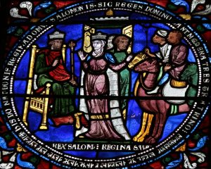 Solomon and the Queen of Sheba. She's white but her attendants are black and ride camels. Canterbury, England, 1180 AD