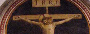 Jesus on the Cross, by Fra Angelico. He has nails through his hands.