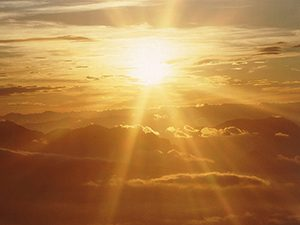 Sunshine breaking through the clouds: a photon is a particle of light