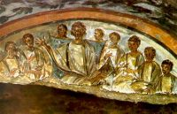 a wall painting of men sitting around a table eating together, with a larger man in the middle.