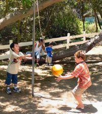 Kids playing tetherball using centrifugal force