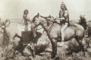 Utes riding horses in the 1800s AD