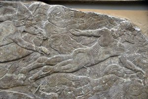 Assyrian men swimming (Nimrud palace, ca. 860 BC, now in British Museum, photo credit Brian McMorrow)
