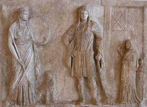 Cybele and Attis standing together, while two much smaller human worshippers pray to them. From the Hellenistic kingdoms, in what is now Turkey, in the 100s BC