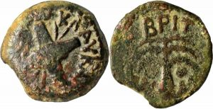 A Roman coin from Judaea, from the reign of Claudius, with crossed shields and spears on one side, and a palm tree on the other side.