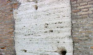 Part of the Colosseum in Rome, with the lead clamps removed for reuse.