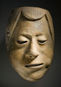 Mask of a man chewing coca leaves (1200s AD, Columbia)