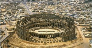 A large circular building in the middle of a town - where Roman gladiators fought