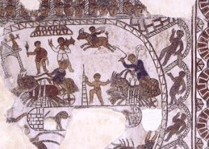 A mosaic from the 500s AD in Gafsa (North Africa), now in the Bardo Museum Can you see the people sitting in the stands? The central posts to turn around? The charioteers whipping the horses? - Roman circus games