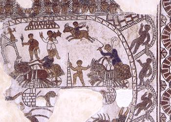 A mosaic from the 500s AD in Gafsa (North Africa), now in the Bardo Museum Can you see the people sitting in the stands? The central posts to turn around?The charioteers whipping the horses?