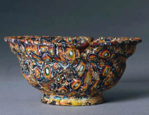 a fancy bowl in swirls of colored glass