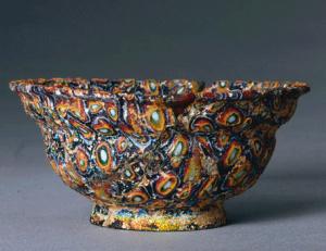 a fancy bowl in swirls of colored glass