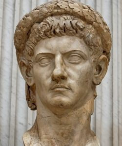 The Roman emperor Claudius in marble: a white man with a rather nasty expression