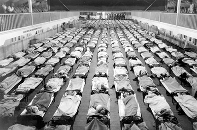 People sick with influenza in bed in a US Navy training station in California (1918)