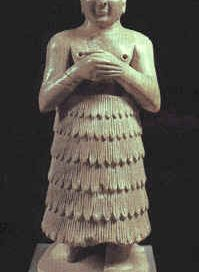 A statue of a worshipper from Mari, on the Euphrates river in Mesopotamia (modern Iraq).