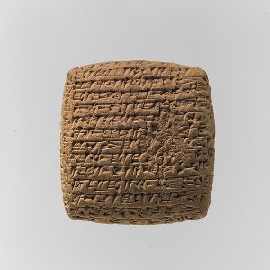 a clay tablet with lots of tiny marks on it