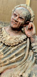 Etruscan tomb sculpture of an older man leaning his head on his hand: Etruscans
