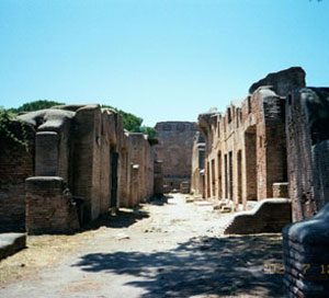 Insulae at Ostia - a street with ruined brick buildings on both sides
